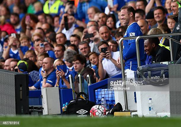 Wayne Rooney of Everton and Manchester United is watched closely by Everton fans as he is about to replace Tom Cleverley of Everton during the Duncan...