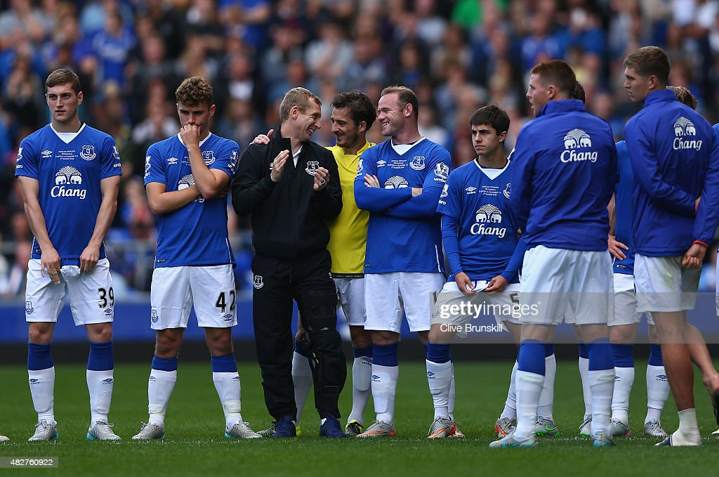 Wayne Rooney of Everton and Manchester United shares a joke Tony Hibbert of Everton at the end of the Duncan Ferguson Testimonial match between Everton and Villarreal at Goodison Park on August 2, 2015 in Liverpool, England.