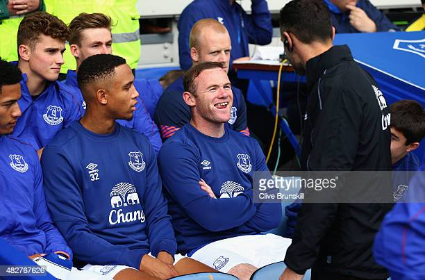 Wayne Rooney of Everton and Manchester United sits in the team dugout during the Duncan Ferguson Testimonial match between Everton and Villarreal at...