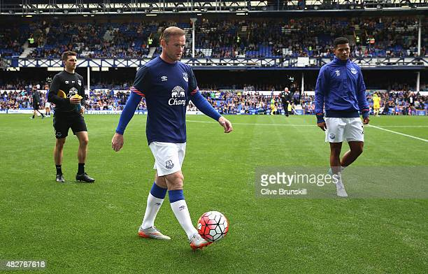 Wayne Rooney of Everton and Manchester United walks off the pitch after the warm up prior to the Duncan Ferguson Testimonial match between Everton...