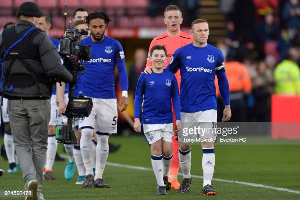 Wayne Rooney of Everton and mascot Georger Shaw during the Premier League match between Watford and Everton at Vicarage Road on February 24 2017 in...