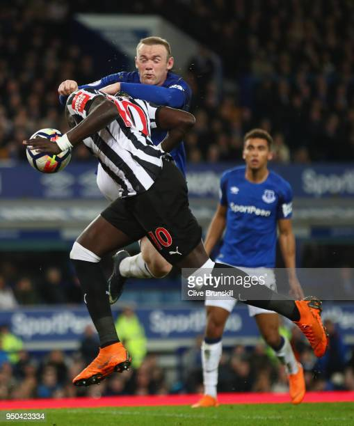 Wayne Rooney of Everton and Mohamed Diame of Newcastle United battle for possession in the air during the Premier League match between Everton and...