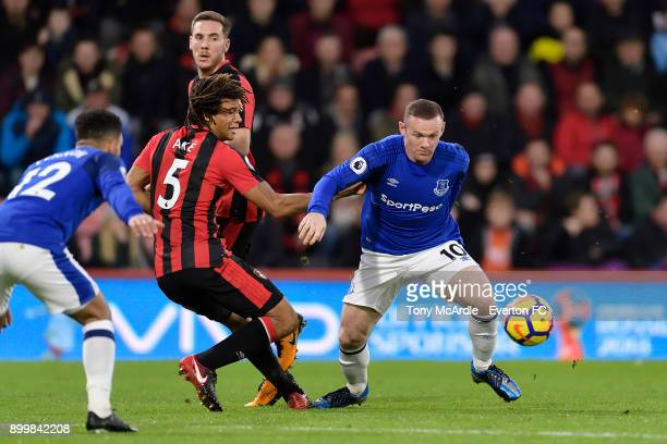 Wayne Rooney of Everton and Nathan Ake challenge for the ball during the Premier League match between AFC Bournemouth and Everton at the Vitality...