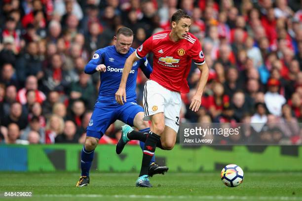Wayne Rooney of Everton and Nemanja Matic of Manchester United battle for possession during the Premier League match between Manchester United and...