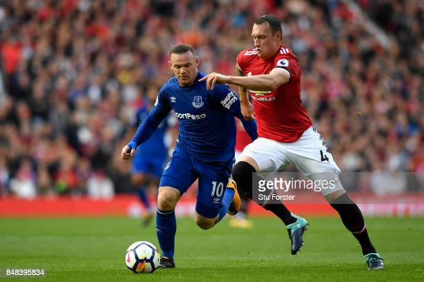 Wayne Rooney of Everton and Phil Jones of Manchester United battle for possession during the Premier League match between Manchester United and...