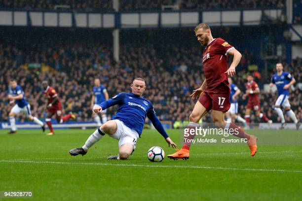 Wayne Rooney of Everton and Ragnar Klavan challenge for the ball during the Premier League match between Everton and Liverpool at Goodison Park on...