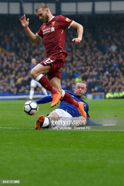 Wayne Rooney of Everton and Ragnar Klavan of Liverpool challenge for the ball during the Premier League match between Everton and Liverpool at...
