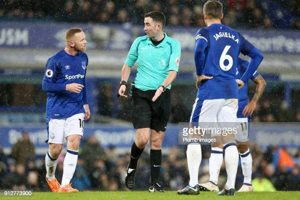Wayne Rooney of Everton argues the penalty decision with referee Christopher Kavanagh during the Premier League match between Everton and Leicester...