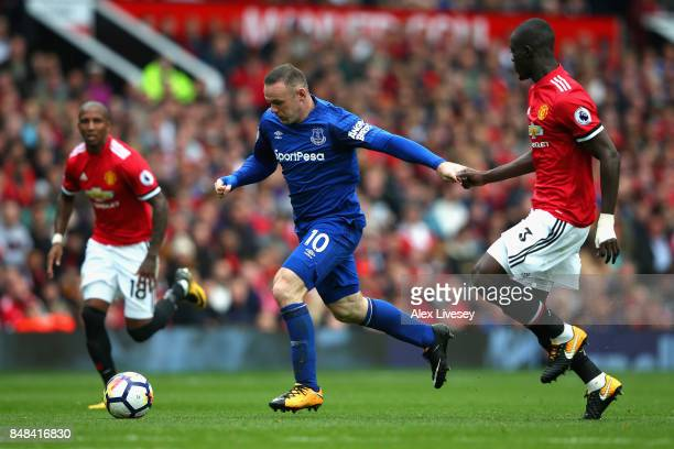Wayne Rooney of Everton attempts to get past Eric Bailly of Manchester United during the Premier League match between Manchester United and Everton...