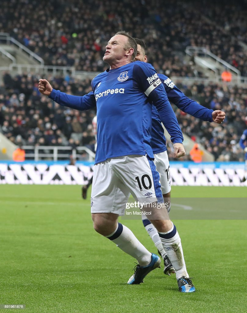 Wayne Rooney of Everton celebrates after he scores the opening goal during the Premier League match between Newcastle United and Everton at St. James Park on December 13, 2017 in Newcastle upon Tyne, England.