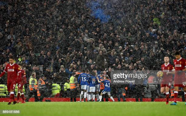 Wayne Rooney of Everton celebrates after scoring a penalty during the Premier League match between Liverpool and Everton at Anfield on December 10...