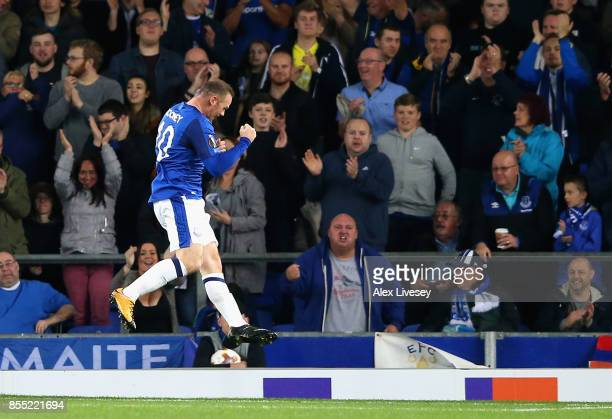 Wayne Rooney of Everton celebrates after scoring his sides first goal during the UEFA Europa League group E match between Everton FC and Apollon...