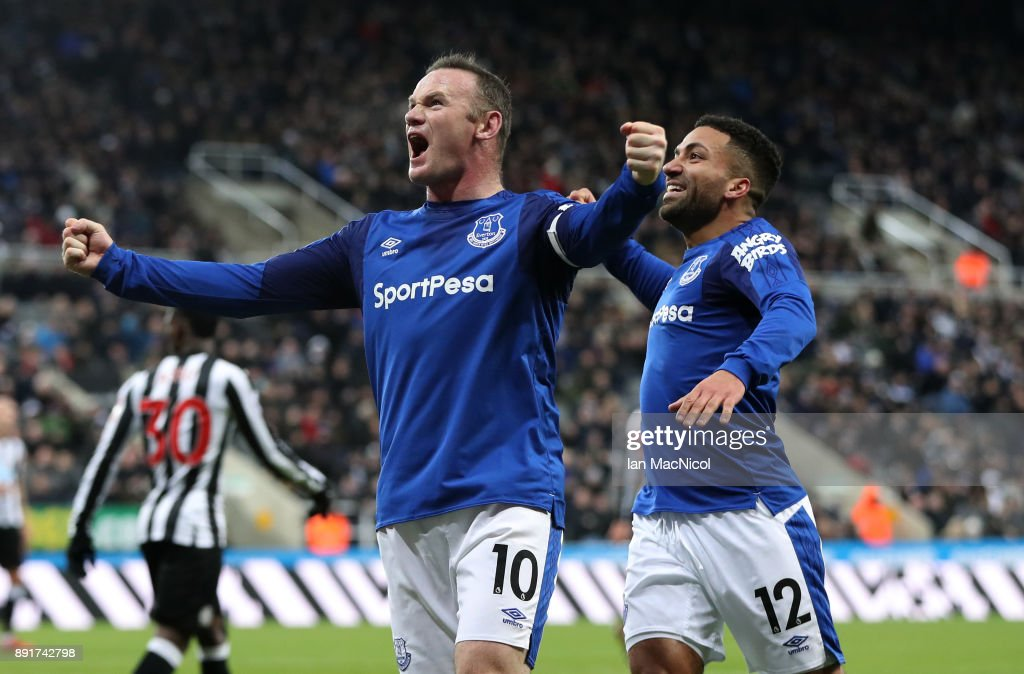 Wayne Rooney of Everton celebrates after scoring his sides first goal with Aaron Lennon of Everton during the Premier League match between Newcastle United and Everton at St. James Park on December 13, 2017 in Newcastle upon Tyne, England.