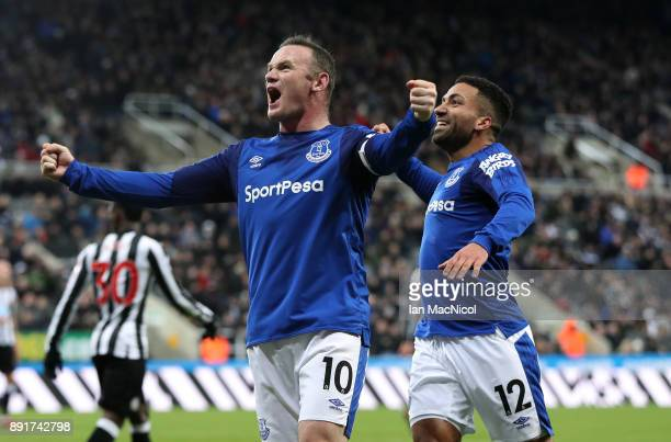Wayne Rooney of Everton celebrates after scoring his sides first goal with Aaron Lennon of Everton during the Premier League match between Newcastle...