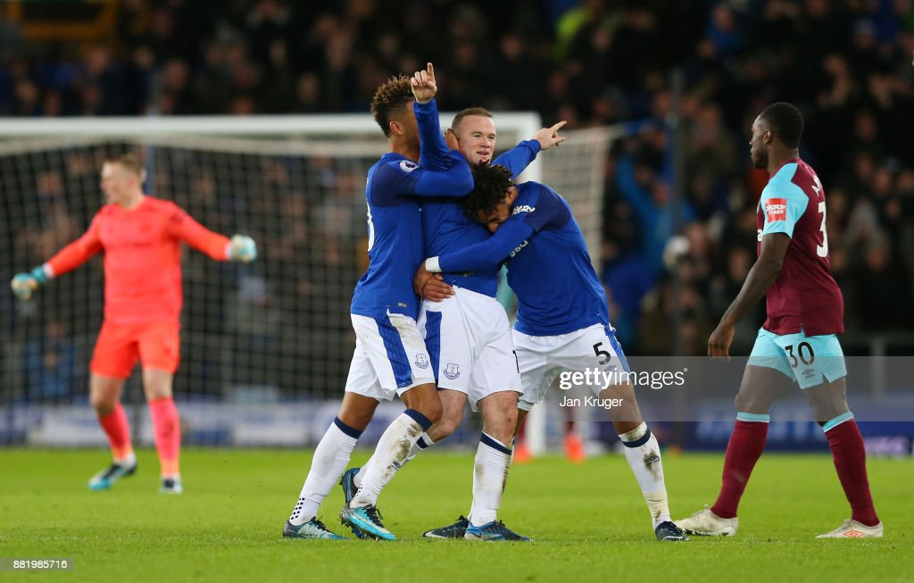 Wayne Rooney of Everton celebrates after scoring his sides third goal with Ashley Williams of Everton and Mason Holgate of Everton during the Premier League match between Everton and West Ham United at Goodison Park on November 29, 2017 in Liverpool, England.