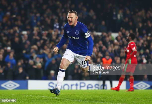 Wayne Rooney of Everton celebrates as he scores their third goal from the penalty spot during the Premier League match between Everton and Swansea...