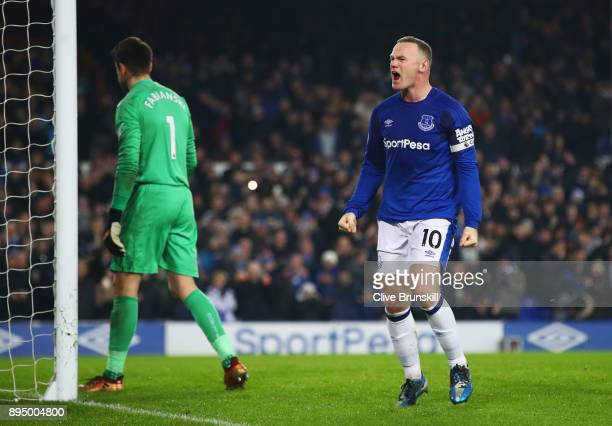 Wayne Rooney of Everton celebrates as he scores their third goal from the penalty spot as Lukasz Fabianski of Swansea City looks dejected during the...