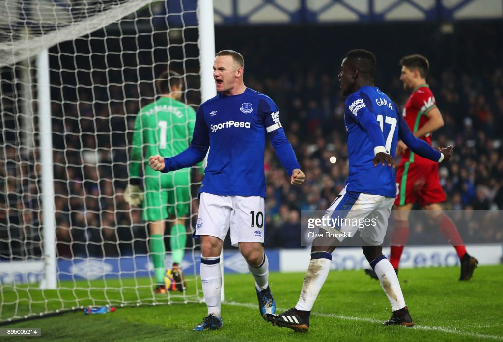 Wayne Rooney of Everton celebrates as he scores their third goal from the penalty spot with Idrissa Gueye during the Premier League match between Everton and Swansea City at Goodison Park on December 18, 2017 in Liverpool, England.