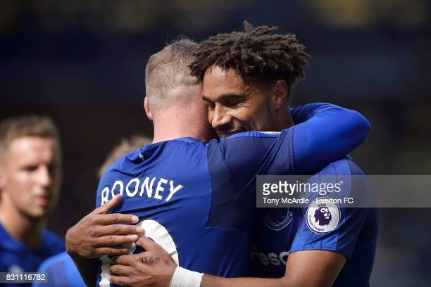 Wayne Rooney of Everton celebrates his goal with Ashley Williams during the Premier League match between Everton and Stoke City at Goodison Park on...