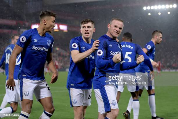 Wayne Rooney of Everton celebrates his goal with Jonjoe Kenny during the Premier League match between Liverpool and Everton at Anfield on December 10...