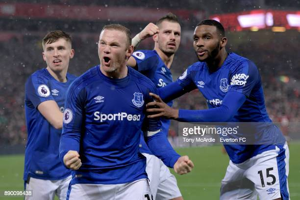 Wayne Rooney of Everton celebrates his goal with Jonjoe Kenny Morgan Schneiderlin and Cuco Martina during the Premier League match between Liverpool...