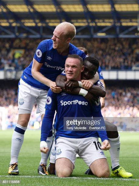 Wayne Rooney of Everton celebrates his goal with team mates Davy Klaassen and Idrissa Gueye during the Premier League match between Everton and Stoke...