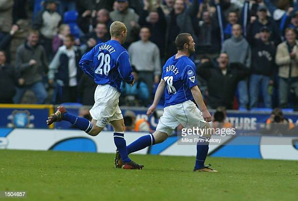 Wayne Rooney of Everton celebrates scoring during the FA Barclaycard Premiership match between Everton and Arsenal at Goodison Park in Liverpool on...