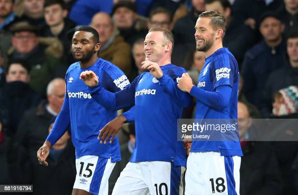 Wayne Rooney of Everton celebrates scoring his sides second goal with team mates Cuco Martina and Gylfi Sigurdsson during the Premier League match...