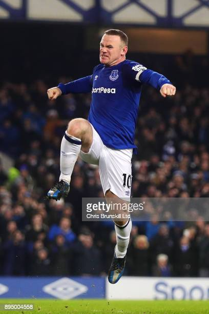 Wayne Rooney of Everton celebrates scoring his side's third goal during the Premier League match between Everton and Swansea City at Goodison Park on...