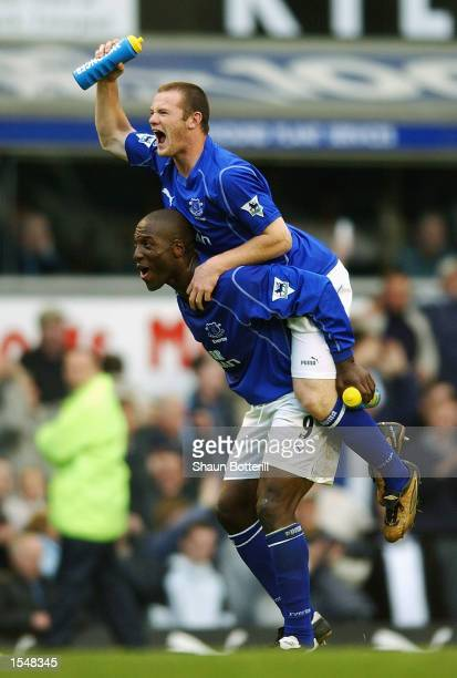 Wayne Rooney of Everton celebrates with Keven Campbell after scoring the winner in the FA Barclaycard Premiership match between Everton and Arsenal...