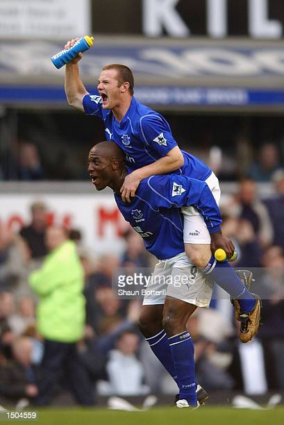 Wayne Rooney of Everton celebrates with Keven Campbell during the FA Barclaycard Premiership match between Everton and Arsenal at Goodison Park in...