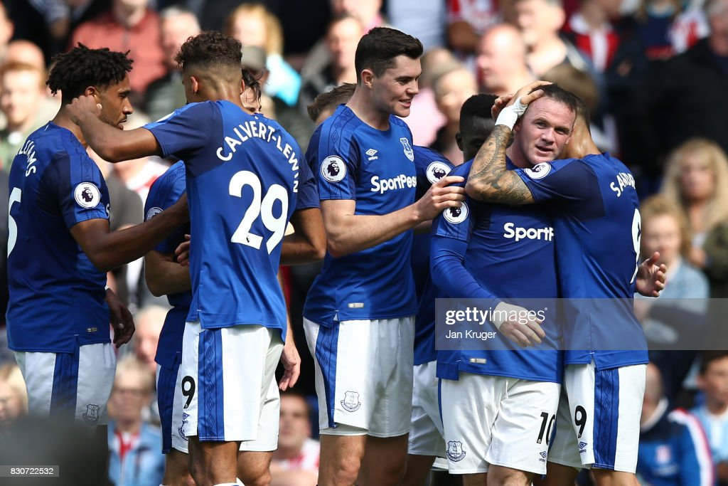 Wayne Rooney of Everton celebrates with teammates after scoring the opening goal during the Premier League match between Everton and Stoke City at Goodison Park on August 12, 2017 in Liverpool, England.