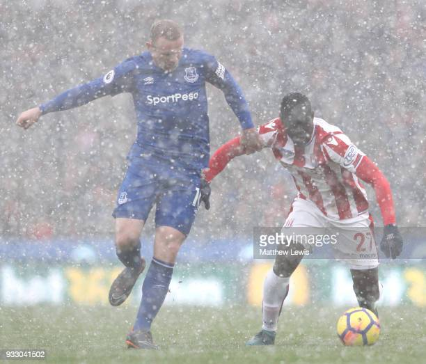 Wayne Rooney of Everton chases down Badou Ndiaye of Stoke City during the Premier League match between Stoke City and Everton at Bet365 Stadium on...