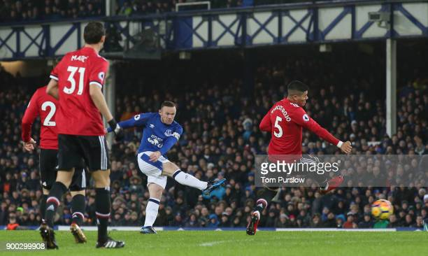 Wayne Rooney of Everton has a shot on goal during the Premier League match between Everton and Manchester United at Goodison Park on January 1 2018...