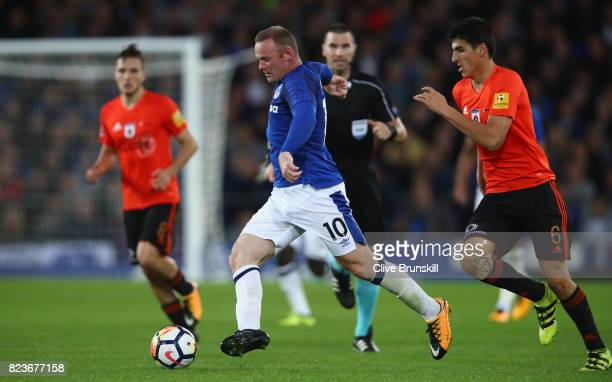 Wayne Rooney of Everton in action with Kristi Qose of MFK Ruzomberok during the UEFA Europa League Third Qualifying Round First Leg match between...
