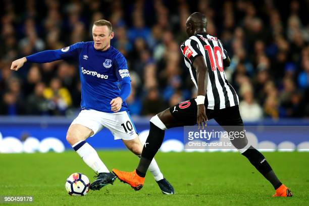 Wayne Rooney of Everton in action with Mohamed Diame of Newcastle United during the Premier League match between Everton and Newcastle United at...