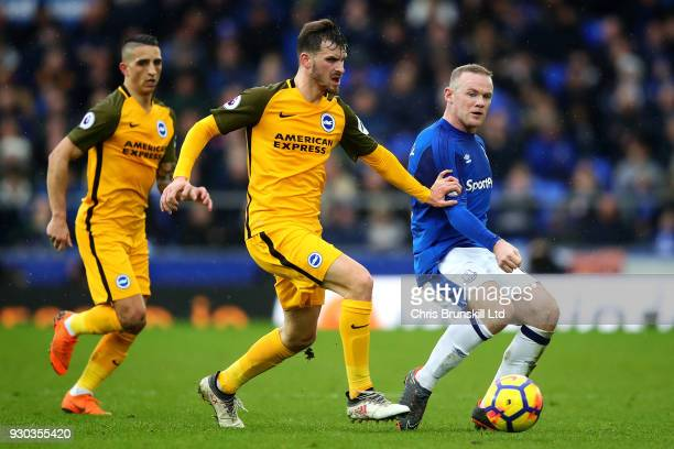 Wayne Rooney of Everton in action with Pascal Gross of Brighton and Hove Albion during the Premier League match between Everton and Brighton and Hove...