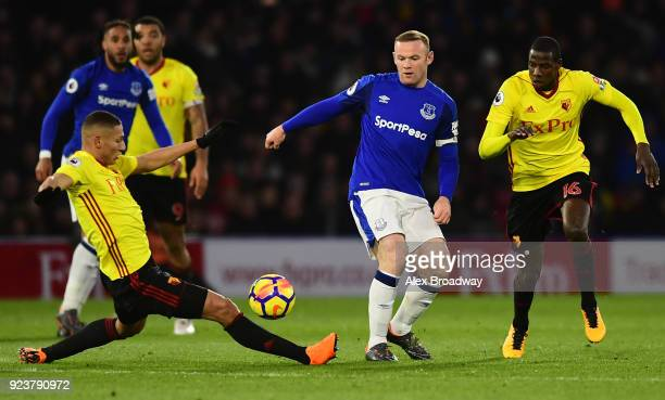 Wayne Rooney of Everton is challenged by Richarlison de Andrade of Watford during the Premier League match between Watford and Everton at Vicarage...