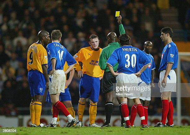 Wayne Rooney of Everton is shown a yellow card during the FA Barclaycard Premiership match between Portsmouth and Everton at Fratton Park on December...