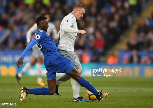 Wayne Rooney of Everton is tackled by Wilfred Ndidi of Leicester City during the Premier League match between Leicester City and Everton at The King...