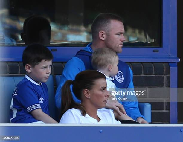 Wayne Rooney of Everton looks on with Coleen Rooney and their children during the Premier League match between Everton and Southampton at Goodison...