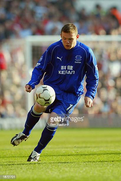 Wayne Rooney of Everton looks to motor forward during the FA Barclaycard Premiership match between Arsenal and Everton held on March 23 2003 at...