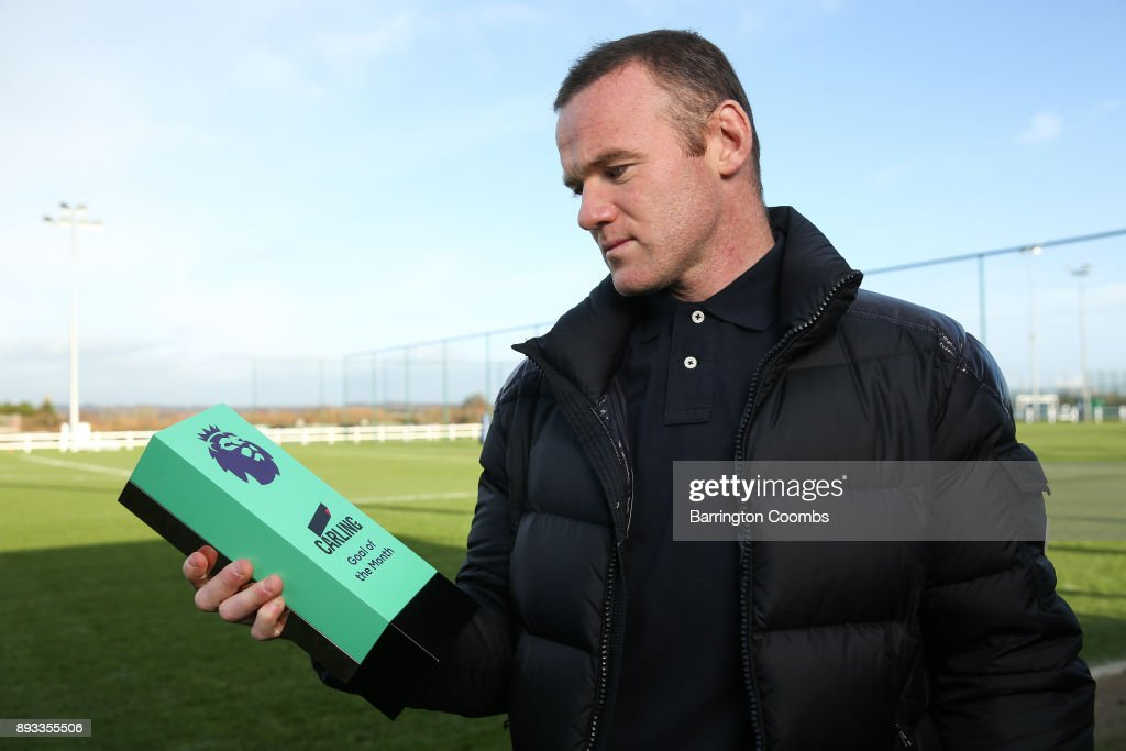 Wayne Rooney of Everton poses with the trophy for Carling Premier League Goal of the Month for November 2017 at USM Finch Farm on December 14, 2017 in Halewood, England.