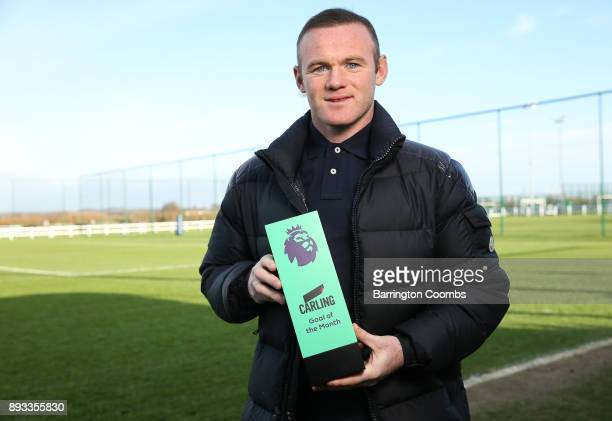Wayne Rooney of Everton poses with the trophy for Carling Premier League Goal of the Month for November 2017 at USM Finch Farm on December 14 2017 in...