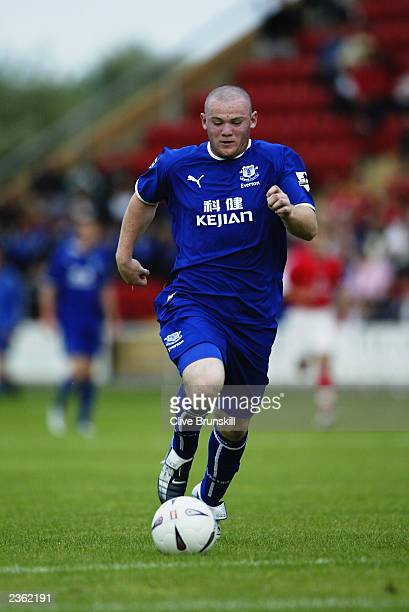 Wayne Rooney of Everton runs with the ball during the PreSeason Friendly match between Crewe Alexandra and Everton held on July 22 2003 at Gresty...