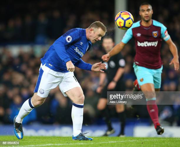 Wayne Rooney of Everton scores his sides first goal during the Premier League match between Everton and West Ham United at Goodison Park on November...