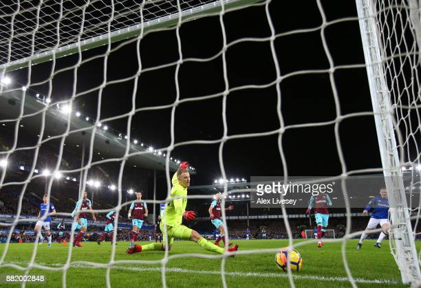Wayne Rooney of Everton scores his sides second goal past Joe Hart of West Ham United during the Premier League match between Everton and West Ham...