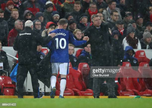 Wayne Rooney of Everton shakes hand with Sam Allardyce Manager of Everton during the Premier League match between Liverpool and Everton at Anfield on...