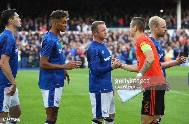 Wayne Rooney of Everton shakes hands with Dominik Kruzllak of MFK Ruzomberok prior to the UEFA Europa League Third Qualifying Round First Leg match...