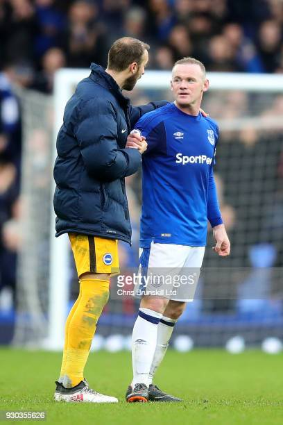 Wayne Rooney of Everton shakes hands with Glenn Murray of Brighton and Hove Albion following the Premier League match between Everton and Brighton...